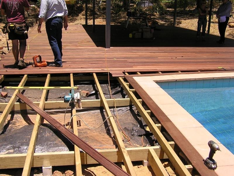 Laying outdoor timber decking for Patio areas